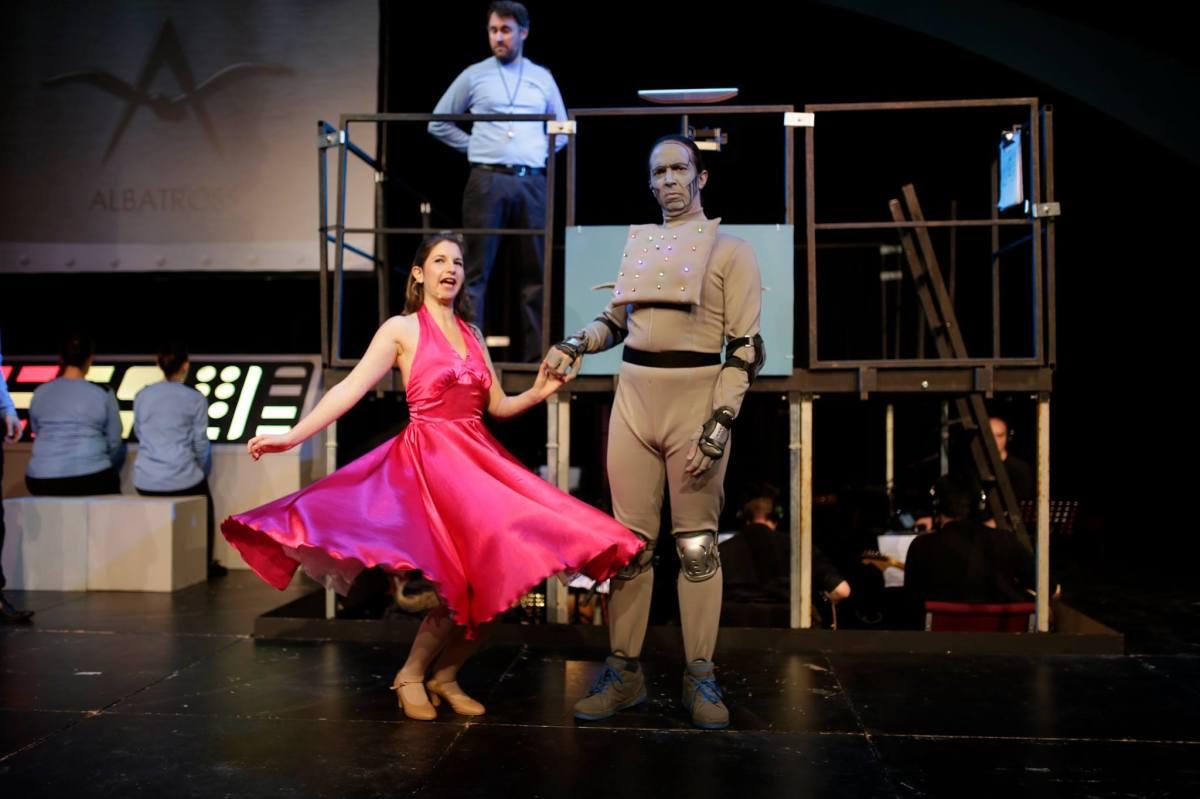 Arial and Miranda dance, while Bosun Arras looks on; photo by Timothy Winn